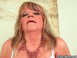 7:03 - Grandmother with large breasts pushes huge dildo inside -