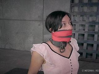 6:36 - Petite Brunette in Metal Bondage -