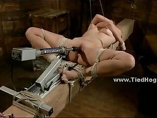 Cute babe tortured with ropes