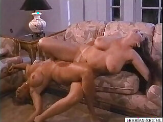 8:25 - Blonde brunette lesbians suck and rub pussies together on couch Get CAMS of girls like this o -
